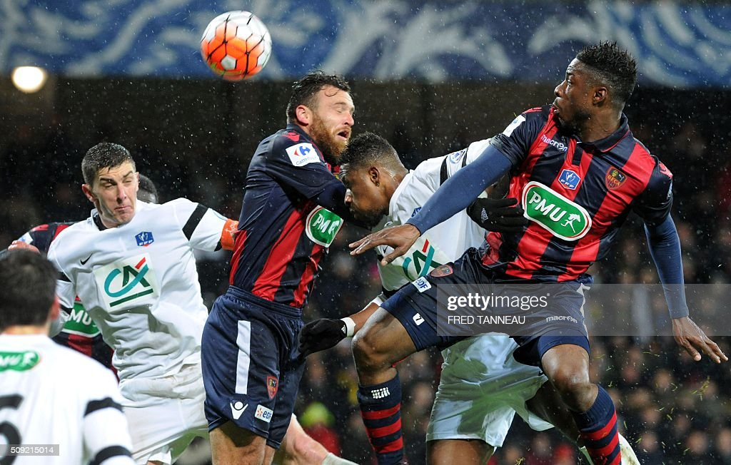 Saint-Malo's defender Samba Toure (2nd R) vies with Ajaccio's French defender Roderic Filippi (3rd R) and Ajaccio's French forward Kevin Mayi (R) during the French Cup football match between Saint-Malo and Ajaccio at Roudourou stadium in Guingamp, western of France, on February 9, 2016. / AFP / FRED TANNEAU