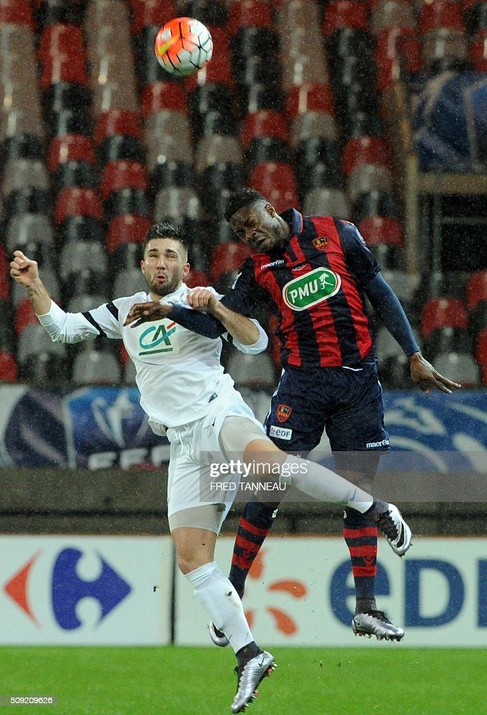 Saint-Malo's forward Remy Jous vies with Ajaccio's French forward Kevin Mayi during a French Cup football match between Saint-Malo and Ajaccio on February 9, 2016 at the Roudourou stadium in Guingamp, western of France. / AFP / FRED TANNEAU