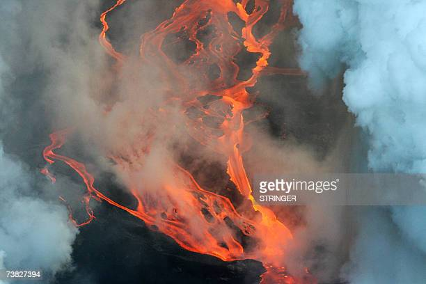 Aerial view taken 06 April 2007 near SaintPhilippe in the French oversea island of La Reunion of lava coming out the Piton de la Fournaise volcano...