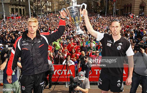 Saints captain Nick Riewoldt and Magpies captain Nick Maxwell hold the premiership cup aloft during the AFL Grand Final Parade on September 24 2010...