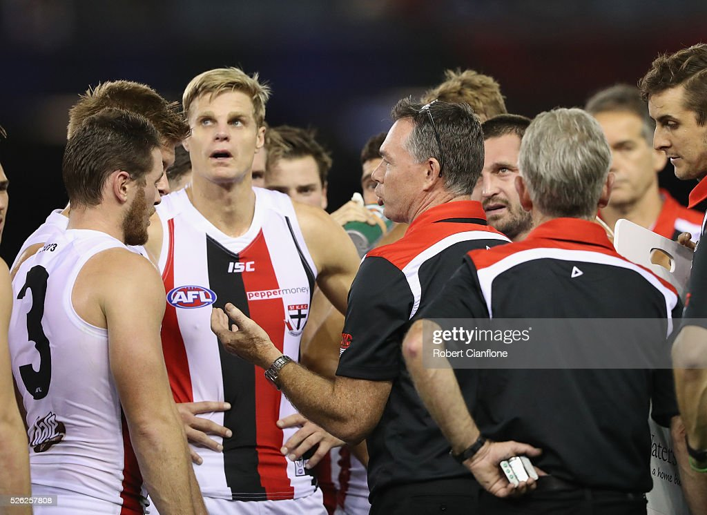 Saints coach Alan Richardson speaks to his players at the break during the round six AFL match between the Melbourne Demons and the St Kilda Saints at Etihad Stadium on April 30, 2016 in Melbourne, Australia.