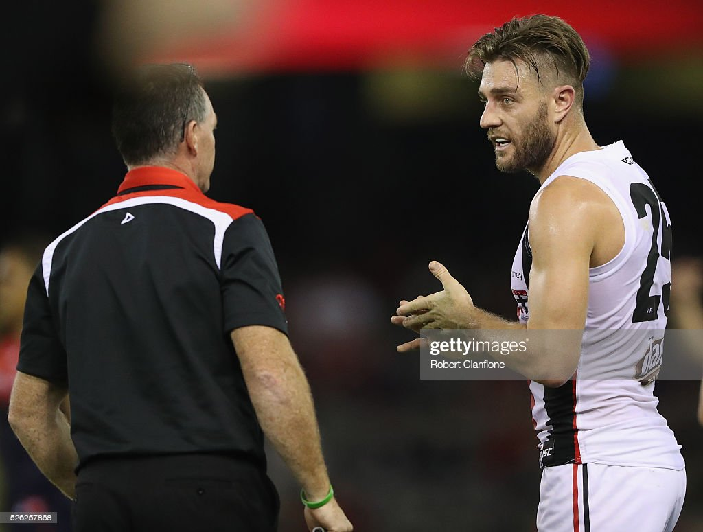 Saints coach Alan Richardson speaks to Sam Fisher during the round six AFL match between the Melbourne Demons and the St Kilda Saints at Etihad Stadium on April 30, 2016 in Melbourne, Australia.