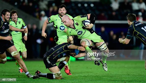 Saints forward Sam Dickinson skips the tackle of Ospreys forward Justin Tipuric during the European Rugby Champions Cup match between Ospreys and...