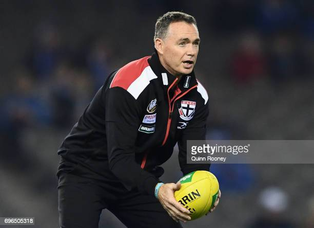 Saints head coach Alan Richardson helps warm up his players during the round 13 AFL match between the North Melbourne Kangaroos and the St Kilda...