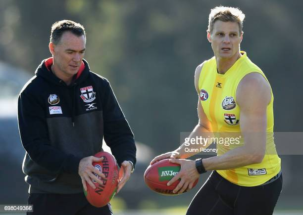 Saints head coach Alan Richardson looks on as Nick Riewoldt kicks during a St Kilda Saints AFL training session at Trevor Barker Beach Oval on June...