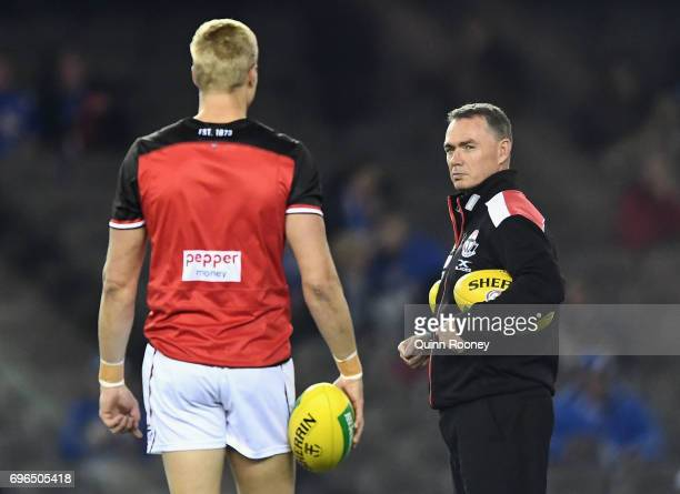 Saints head coach Alan Richardson talks to Nick Riewoldt during the round 13 AFL match between the North Melbourne Kangaroos and the St Kilda Saints...