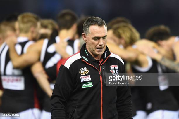 Saints head coach Alan Richardson walks away from talking to his players during the round 13 AFL match between the North Melbourne Kangaroos and the...