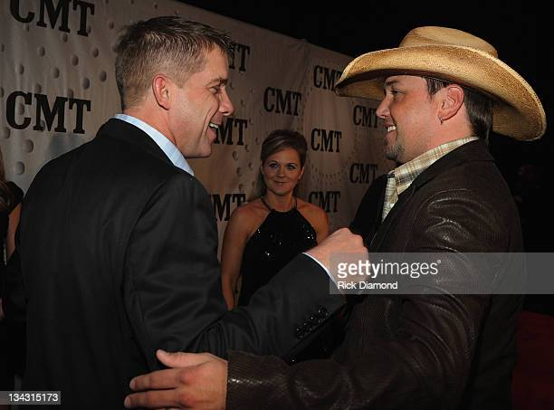 O Saints head coach Sean Payton and Honoree Jason Aldean attend the 2011 CMT Artists of the year celebration at the Bridgestone Arena on November 29...