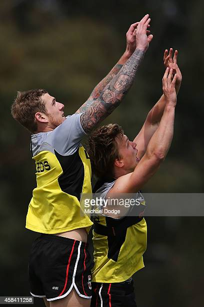 Saints newest recruit Tim Membrey competes for the ball against Daniel Markworth during a StKilda Saints AFL media session at Linen House Oval on...