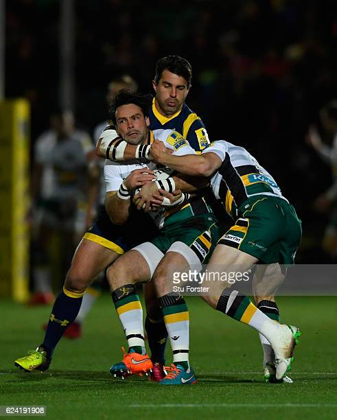 Saints player Ben Foden is tackled by Wynand Olivier of the Warriors during the Aviva Premiership match between Worcester Warriors and Northampton...