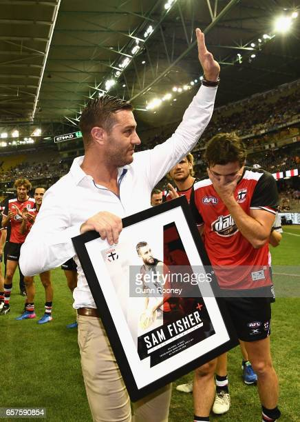 Saints players form a guard of honour for Sam Fisher after he retired during the round one AFL match between the St Kilda Saints and the Melbourne...