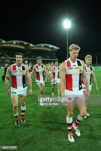 Saints players leave the field lead by their captain Nick Riewoldt after the round 12 AFL match between the Port Adelaide Power and the St Kilda...