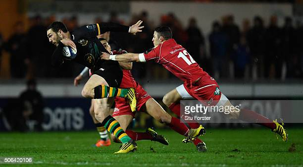 Saints wing George North breaks through the Scarlets centres during the European Rugby Champions Cup match between Scarlets and Northampton Saints at...