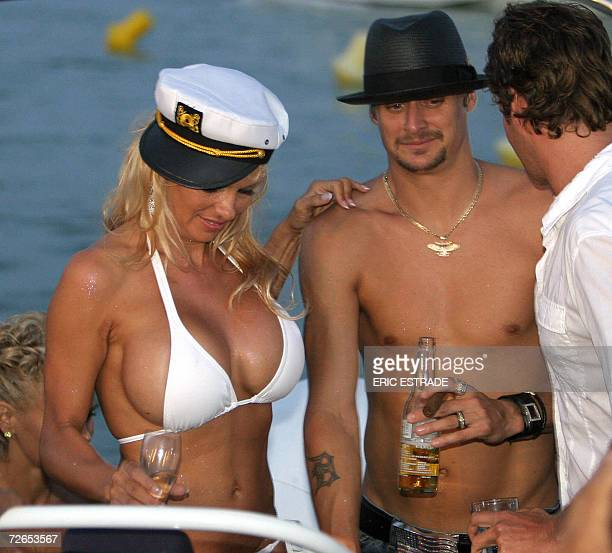 Photo dated 29 July 2006 shows Canadian actress Pamela Anderson sharing a drink with her husband US musician Kid Rock on the day of their wedding on...