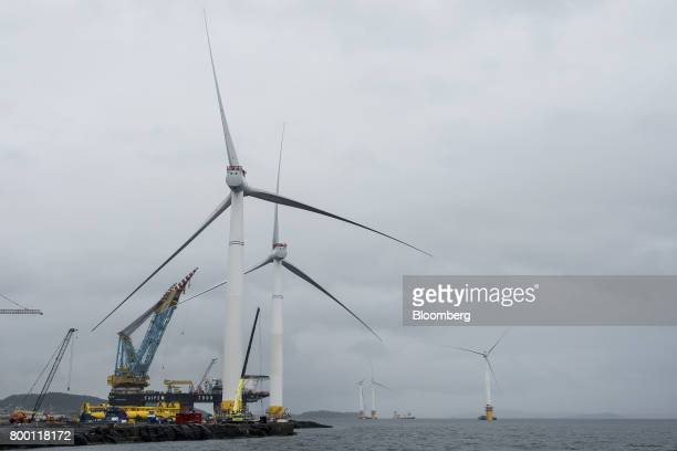 A Saipem SpA 7000 crane vessel operates at the assembly site for offshore floating wind turbines in the Hywind pilot park operated by Statoil ASA in...