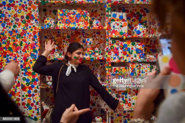 Saira Mirza of Columbia MD sports dots on her face along with her polka dot scarf while posing for pictures as the last visitors apply the final dots...