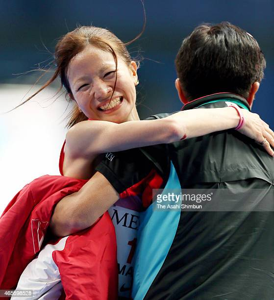 Sairi Maeda of Japan celebrates finishing third and top among Japanese with her coach during the Nagoya Women's Marathon 2015 at Nagoya Dome on March...