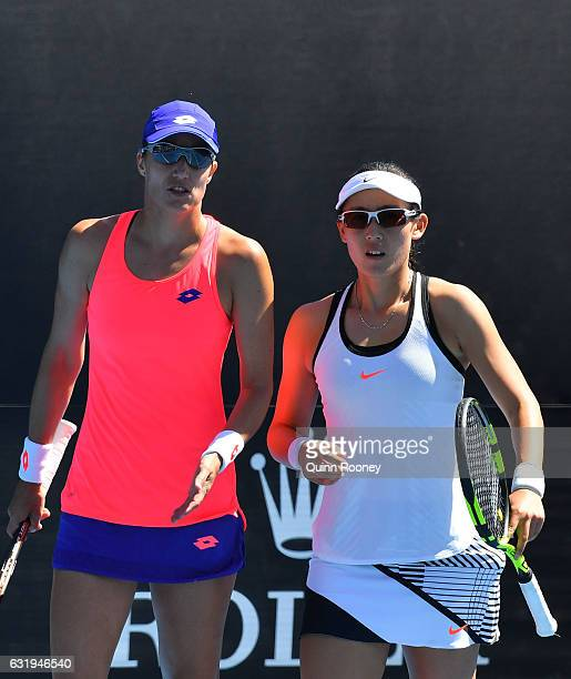 Saisai Zhang of China and Katarina Srebotnik of Slovakia compete against Christina McHale of the United States and Asia Muhammad of the United States...