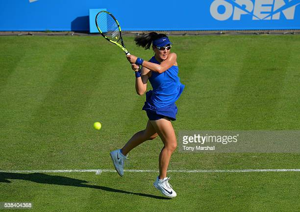 Saisai Zheng of China returns the ball to Freya Christie of Great Britain in her first round match during WTA Aegon Open Nottingham Day 1 at...