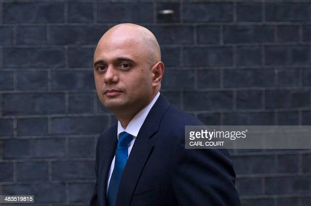 Sajid Javid arrives in Downing Street in central London on April 9 2014 after being appointed to replace Maria Miller as British Culture Secretary...