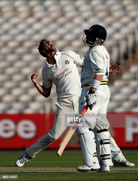 Sajid Mahmood of Lancashire celebrates after taking the wicket of Ian Bell of Warwickshire during the LV County Championship match between Lancashire...