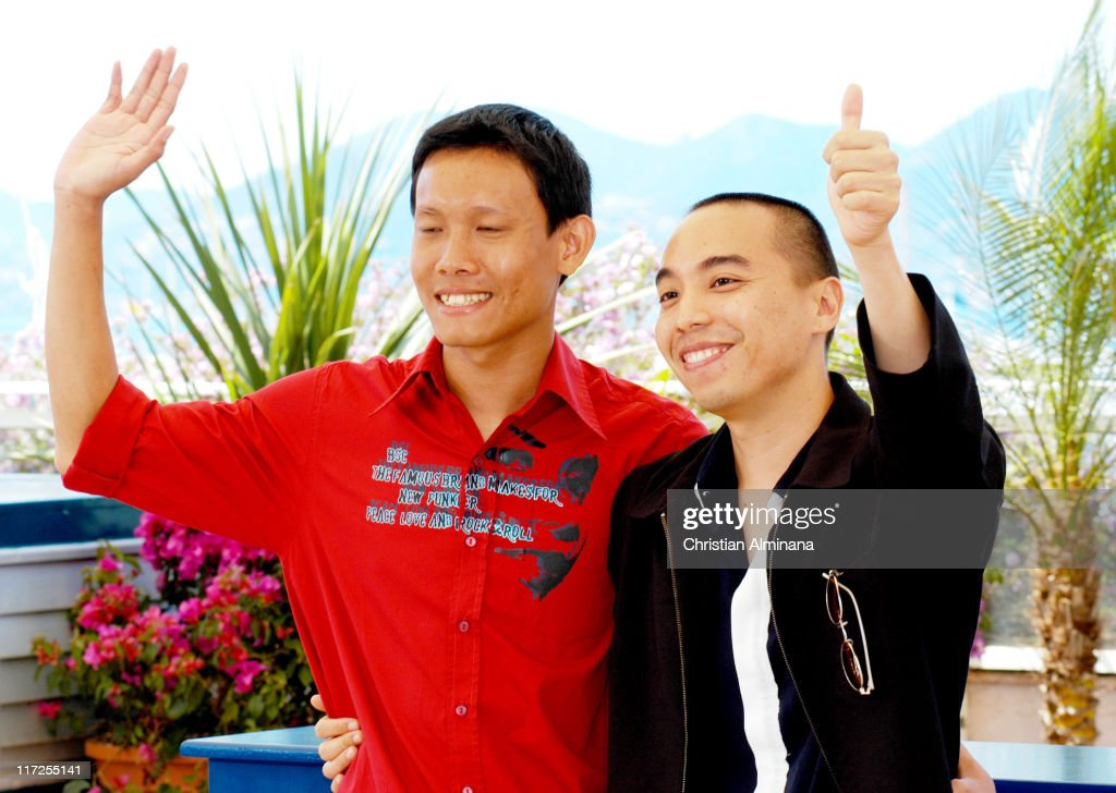 Sakada Kaewbuadee and Apichatpong Weerasethakul during 2004 Cannes Film Festival - Tropical Malady - Photocall at Palais Du Festival in Cannes, France.