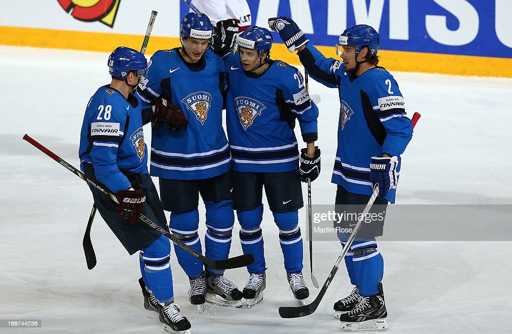 Sakari Salminen (C) of Finland celebrate with his team mates after he scores his team's opening goal the IIHF World Championship group H match between Latvia and Finland at Hartwall Areena on May 14, 2013 in Helsinki, Finland.