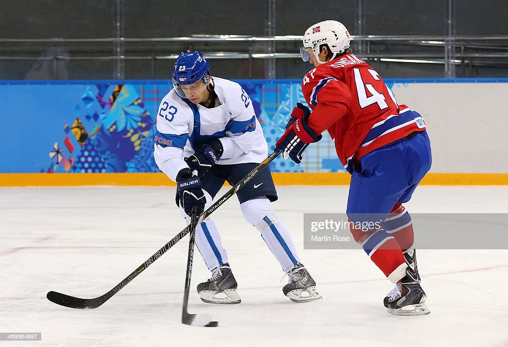 <a gi-track='captionPersonalityLinkClicked' href=/galleries/search?phrase=Sakari+Salminen&family=editorial&specificpeople=4468264 ng-click='$event.stopPropagation()'>Sakari Salminen</a> #23 of Finland handles the puck against <a gi-track='captionPersonalityLinkClicked' href=/galleries/search?phrase=Alexander+Bonsaksen&family=editorial&specificpeople=6744709 ng-click='$event.stopPropagation()'>Alexander Bonsaksen</a> #47 of Norway in the first period during the Men's Ice Hockey Preliminary Round Group B game on day seven of the Sochi 2014 Winter Olympics at Shayba Arena on February 14, 2014 in Sochi, Russia.
