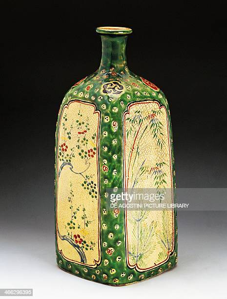 Sake bottle decorated with the Three friends of Winter pine bamboo and plum produced in Kiyomizu late 17th century enamel stoneware height 28 cm...