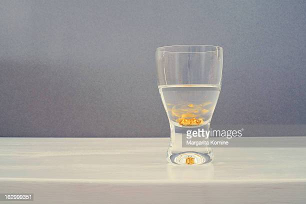 Sake glass with swirling gold flakes