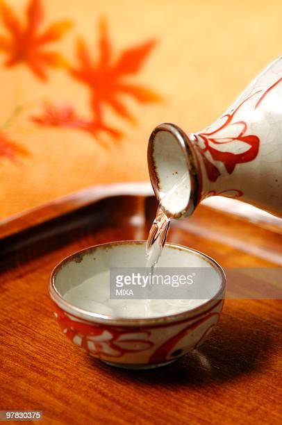 Sake pouring into sake cup