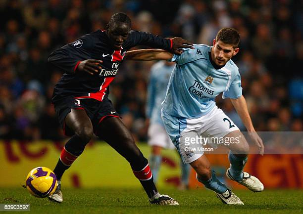 Sakho Mamadou of Paris Saint Germain battles for the ball with Ched Evans of Manchester City during the UEFA Cup Group A match between Manchester...