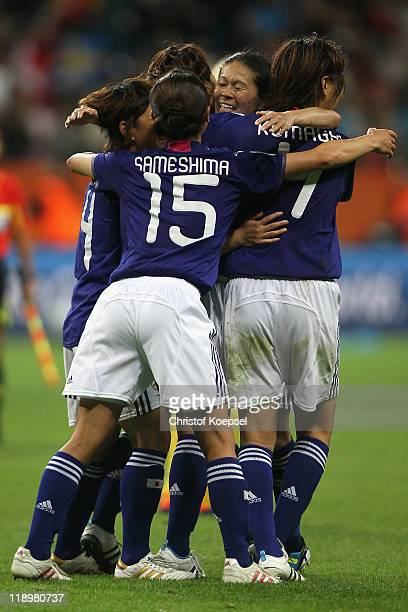 Saki Kumagai Aya Sameshima Homare Sawa and Kozue Ando of Japan celebrate winning 31 the FIFA Women's World Cup Semi Final match between Japan and...