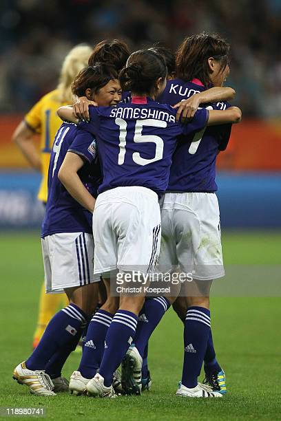 Saki Kumagai Aya Sameshima Kozue Ando of Japan celebrate winning 31 the FIFA Women's World Cup Semi Final match between Japan and Sweden at the FIFA...