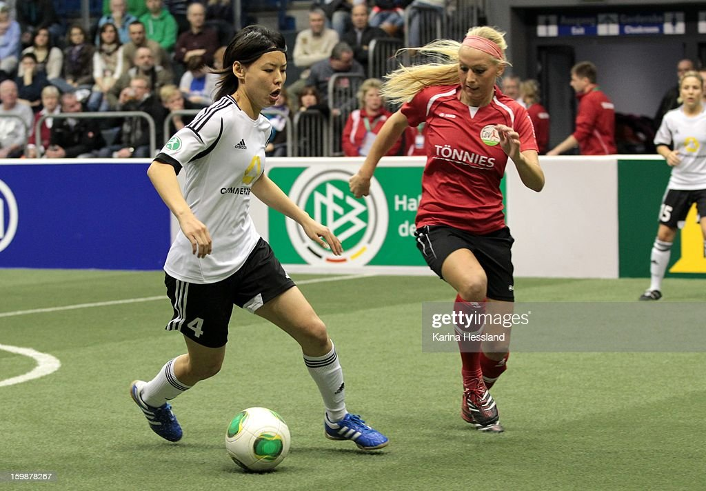 Saki Kumagai of 1.FFC Frankfurt challenges Kristina Gessat of FSV Guetersloh 2009 during the DFB Women's Indoor Cup 2013 at the GETEC-Arena on January 19, 2013 in Magdeburg, Germany.
