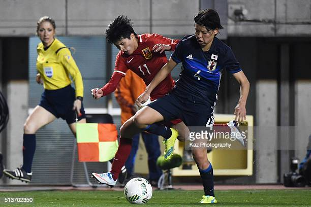 Saki Kumagai of Japan and Wang Shanshan of China compete for the ball during the AFC Women's Olympic Final Qualification Round match between Japan...