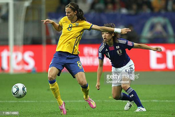 Saki Kumagai of Japan challenges Lotta Schelin of Sweden during the FIFA Women's World Cup Semi Final match between Japan and Sweden at the FIFA...