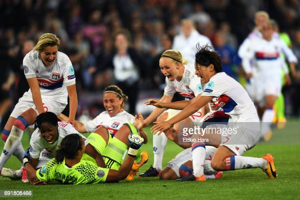 Saki Kumagai of Lyon celebrates with her team mates after her side's victory through the penalty shootout during the UEFA Women's Champions League...