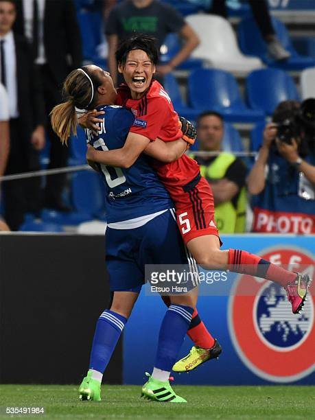 Saki Kumagai of Lyonnais celebrates with her team mate Sarah Bouhaddi after their win through the penalty shootout in the UEFA Women's Champions...