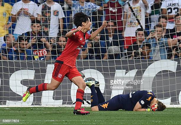 Saki Kumagai of Olympique Lyonnais celebrates after scoring the gamewinning penalty in their 43 shootout victory over Wolfsburg during UEFA Women's...