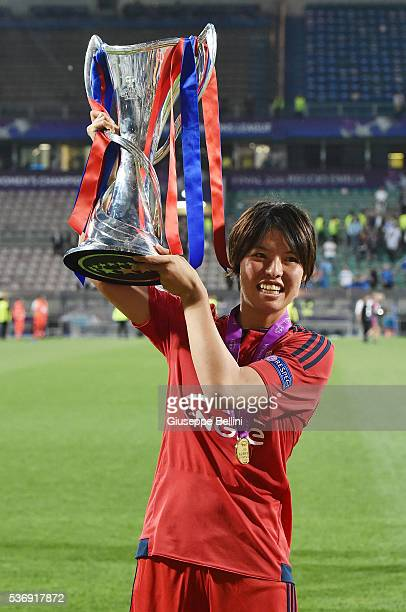 Saki Kumagai of Olympique Lyonnais lifts the winners trophy after UEFA Women's Champions League Final between VfL Wolfsburg v Olympique Lyonnais at...