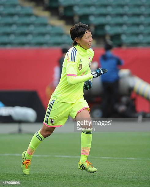 Saki Kumagai of team Japan in action against team Canada during a match at Commonwealth Stadium on October 25 2014 in Edmonton Alberta Canada