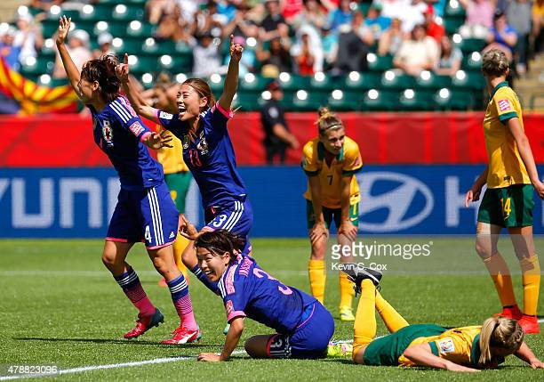 Saki Kumagai Rumi Utsugi and Azusa Iwashimizu of Japan celebrate a goal by Mana Iwabuchi against Australia during the FIFA Women's World Cup Canada...