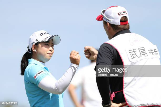 Saki Takeo of Japan celebrates after making her birdie putt on the 17th green during the second round of the Daikin Orchid Ladies Golf Tournament at...