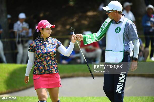 Saki Takeo of Japan celebrates after making her birdie putt on the 1st green during the third round of the Suntory Ladies Open at the Rokko Kokusai...
