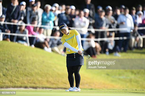 Saki Takeo of Japan chips onto the 17th green during the final round of the Itoen Ladies Golf Tournament 2016 at the Great Island Club on November 13...