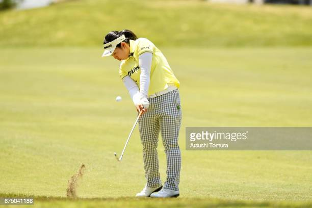 Saki Takeo of Japan hits her second shot on the 9th hole during the final round of the CyberAgent Ladies Golf Tournament at the Grand Fields Country...