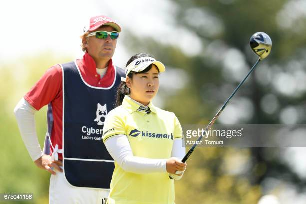 Saki Takeo of Japan lines up her tee shot on the 9th hole during the final round of the CyberAgent Ladies Golf Tournament at the Grand Fields Country...
