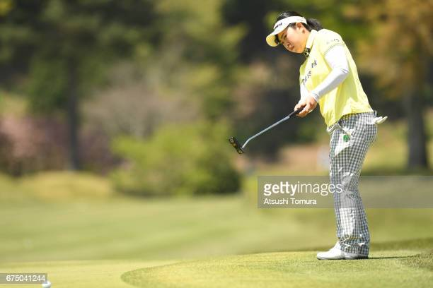 Saki Takeo of Japan putts on the 8th hole during the final round of the CyberAgent Ladies Golf Tournament at the Grand Fields Country Club on April...