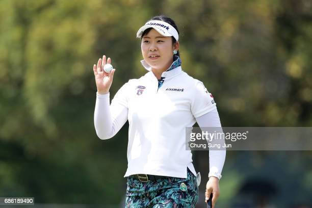 Saki Takeo of Japan reacts after a putt on the 18th green during the final round of the Chukyo Television Bridgestone Ladies Open at the Chukyo Golf...